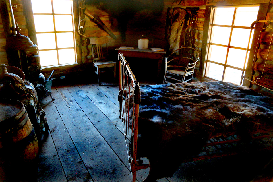 Two windows illuminate the cabin used by The Hole in the Wall Gang (Butch Cassidy and Sundance Kid).