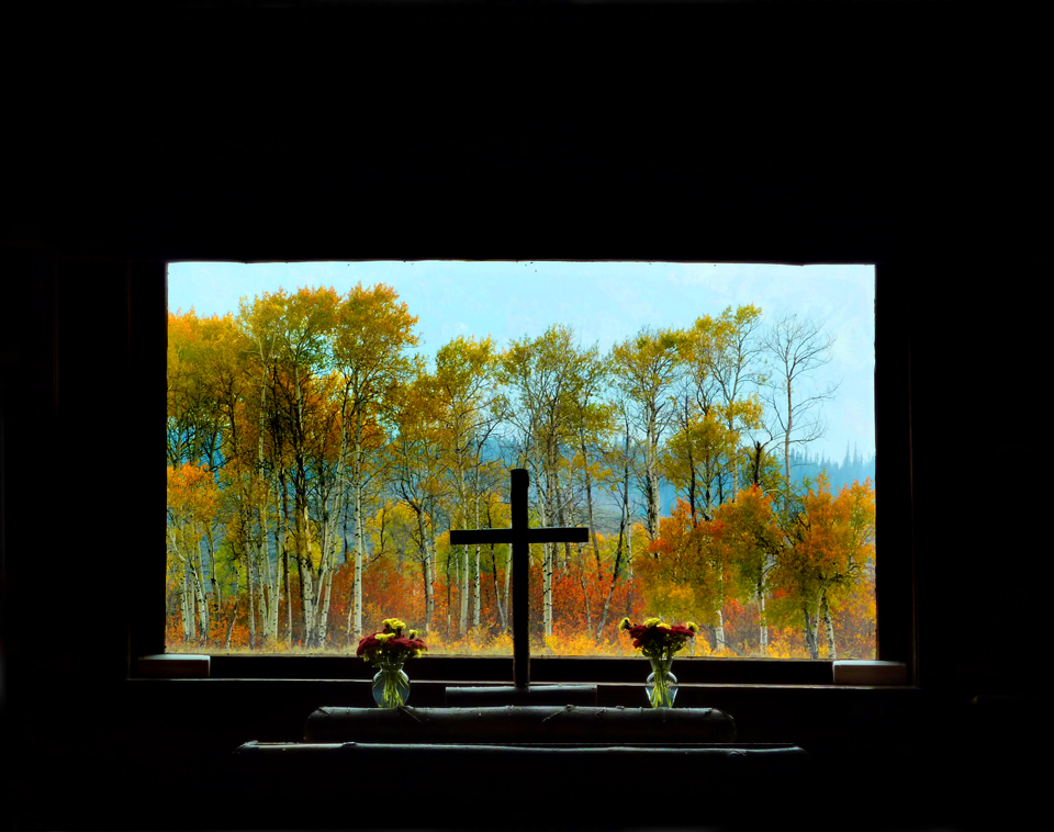 The Church without a stained glass window. Instead it has a view to the autumn trees and the Grand Teton Mountain Range.
