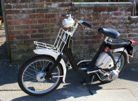 Honda P50 without red basket.